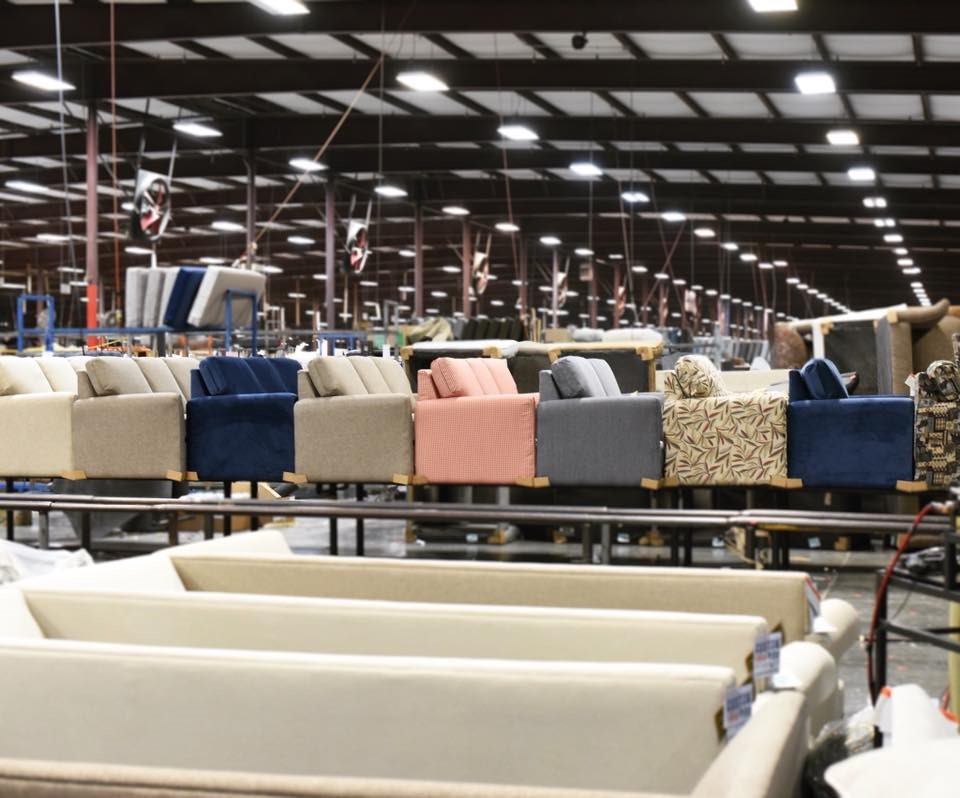 england furniture chairs lined up in assembly line in factory